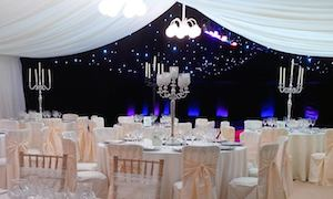 Marquee tables, chairs and starcloth ceiling