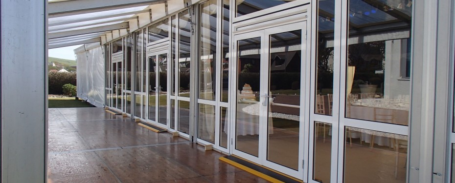 Solid glazed windows and doors for marquees