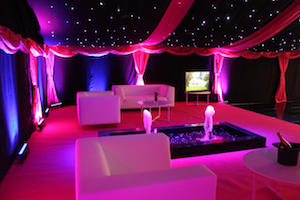 Tents and Events marquee chillout area with fountain, seating, uplighters and star cloth