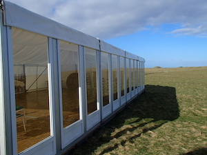 6m, 9m marquee solid glazing external view for a marquee event on the Isle of Iona