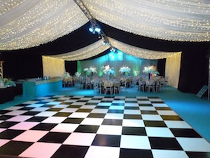 Marquee pea lamp lighting and checkerboard dancefloor