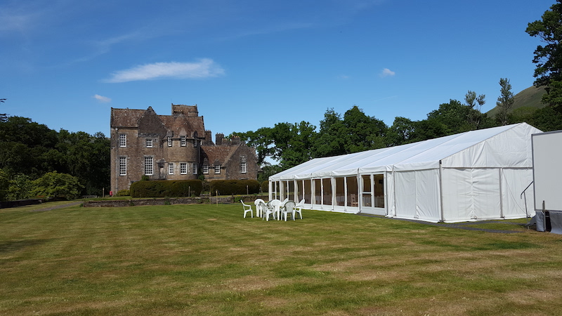 Wedding marquee on the lawn with Adkinglas House in the background