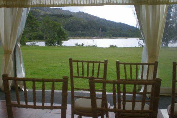 Open window walls overlooking Loch Sheil for a wedding ceremony in 2015