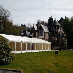 Knockderry House Hotel with our marquee showing the window walls to overlook Loch Long