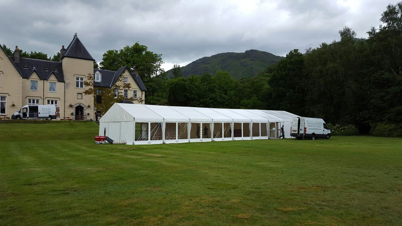 Wedding marquee on the front lawns at the Glenfinnan House Hotel.