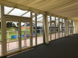 Marquee solid glazing opening windows with exit to veranda.