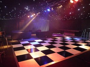 Party marquee chessboard dancefloor entertainment lighting and starcloth